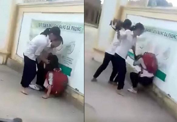 Clip: Nữ sinh lớp 8 bị bạn đánh hội đồng trước cổng trường vì chê mẫu áo mỏng